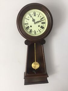 Vintage unique carved solid wood winding wall or mantle clock.