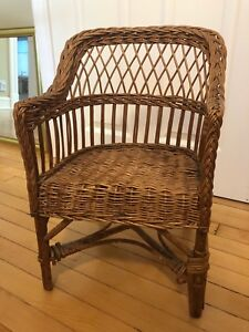 Antique wicker kid's chair. 20 inches high.