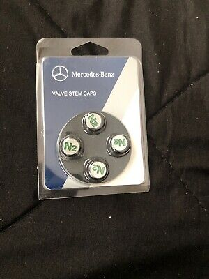 NEW GENUINE MERCEDES BENZ SET OF 4 PLASTIC GREY VALVE CAPS A0004010609