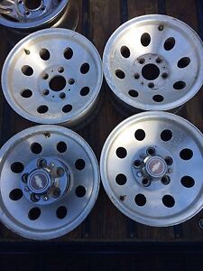 4 Chevy aluminum wheels 15 5x5 bolt pattern