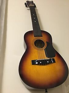 First Act Acoustic guitar 2/4 sized