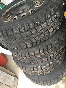 For sale one set of 4 snow tires studied  and rims St. John's Newfoundland image 1