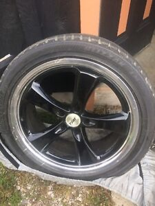 Lightly used snow tires on alloy wheels