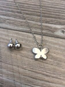 Silver butterfly necklace and silver circle earrings