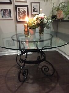 Elegant Glass Table with Rod Iron Base