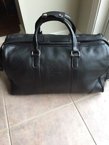 Genuine ROOTS leather duffle bag $150