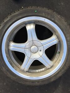 245-40-18 Bridgestone Blizzak Winter Tires on Sacchi Chrome Mags