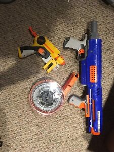 Two nerf guns and large bullet holder