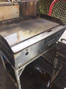2 propane fryers, 1 propane grill, 1 propane steamer