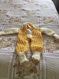 Hand knitted body suit for the newborn
