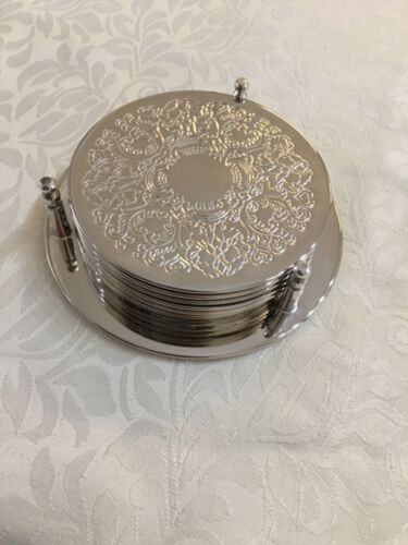 7 piece silver plated coaster set.