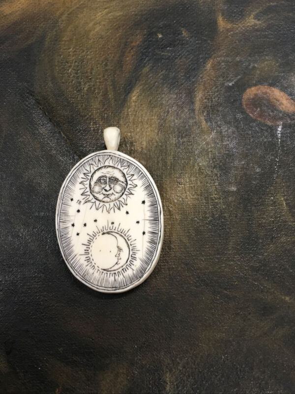 ANTIQUE SCRIMSHAW BUFFALO BONE CELESTIAL SUN CRESENT MOON HAND CARVED PENDANT