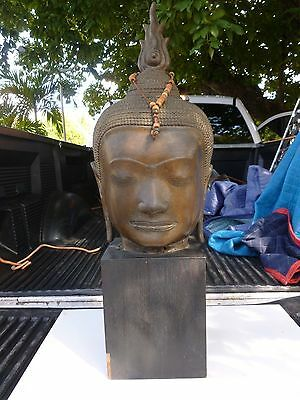 LARGE ANTIQUE BRONZE BUDDHA HEAD ON WOOD BASE POSSIBLY ANGKOR WAT