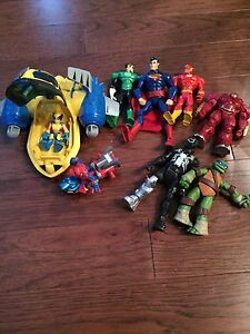 Superhero figures and vehicles