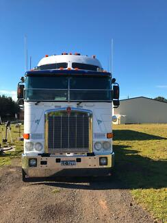 2010 KENWORTH K108  PLUS TRI AXLE TRAILER