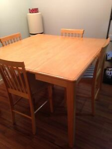 Solid oak table with a leaf extension and chairs