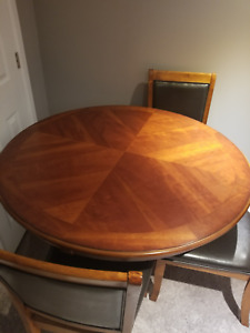 Large Wooden Table for sale ( three free chairs included)