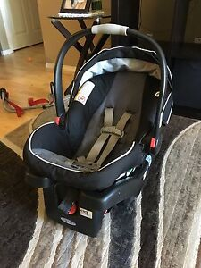 Graco infant car seat with two car bases.
