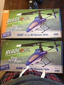 2  Blade MSR helicopters with one remote and lots of extras