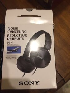 Noise cancelling head phones