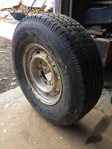 Older full sized spare tire and rim
