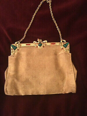 Art nouveau purse in gold fablic, enameled clasp and cabochon stone -