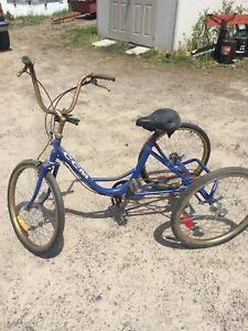 Two(2)  three wheel bicycles