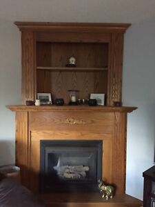 Oak mantle fireplace with gas fireplace insert
