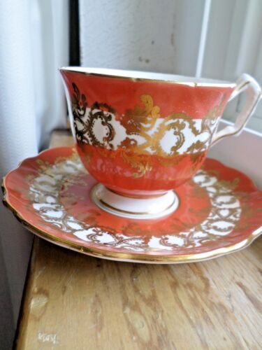 AYNSLEY BURNT ORANGE CUP AND SAUCER MADE IN ENGLAND