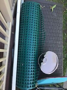 25 foot roll of 4 foot high green plastic safety fence