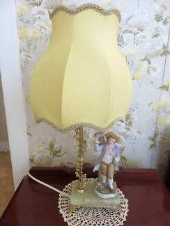 Two bedside table lamps with figurine bases