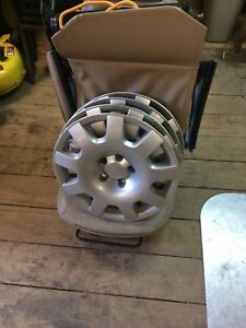 "Saab 15"" hubcaps / seat and seat parts"