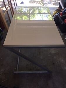 White desk with silver frame