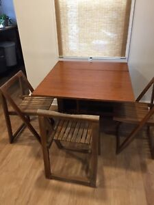 Teak drop leaf dining table + 3 teak folding chairs mid century