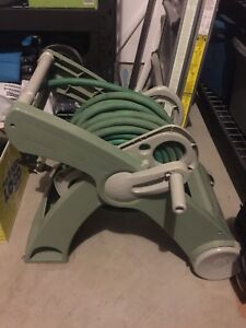 100 feet Garden hose and hose reel with handle (nozzle included)
