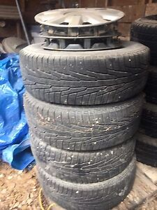 4 tires and rims from a 2005 Chrysler sebring