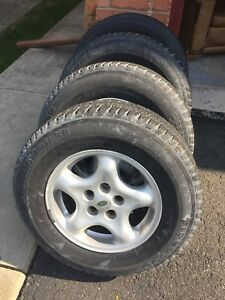 4 Land Rover discovery rims and tires 255/66r16
