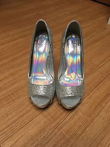 Silver high heels need gone asap