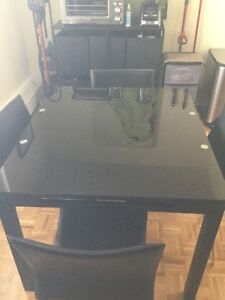 Urban Barn dining room table with 4 Zuo Modern chairs