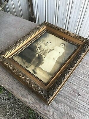 A Vintage Picture Frame With A Picture Of A Couple