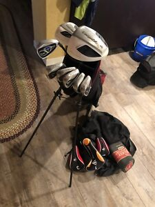 Right handed-Dunlop golf clubs, covers & bag