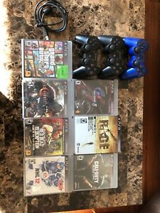 PS3 slim with 3 controllers and 7 games
