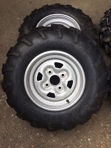 New tires and rims from Yamaha grizzly