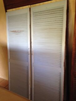 Timber Louver Cupboard Doors Slatted For Ventilation.