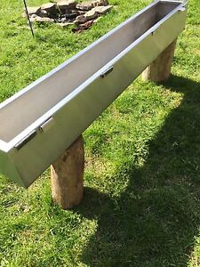 "Stainless steel planter box. 4' 11"" long, 8 1/4"" wide, 7"" deep"