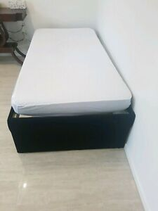 URGENT ..Single upholstered Bed with trundle