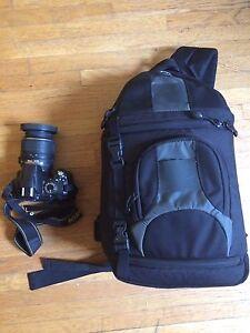 Nikon D3000 with kit lens and slingshot bag