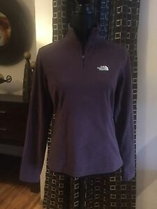 Two woman's North Face Fleece Pullovers
