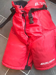 Bauer vapor x3, red hockey player pants size youth large.