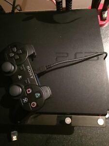 Console de jeu Ps3 230 gig avec deux manettes et 2 jeux